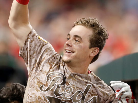 Scooter Gennett waves to fans from the dugout after hitting his Reds record setting fourth home run of the night in the bottom of the eighth inning against the St. Louis Cardinals at Great American Ball Park on June 6, 2017.