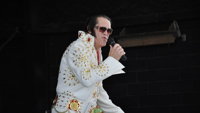 Elvis tribute artist David Holbrook performs at the H-E-B Entertainment Pavilion at the West Texas Fair & Rodeo during Senior Citizens Day on Wednesday, Sept. 13, 2017.