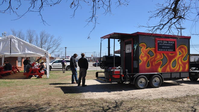 Jay and Diana Stearns want customers to feel like they are eating in a cool back yard at their lot at 602 S. 11th St., where they regularly park their food trailer Jay's BBQ Shack. The picnic tables Jay built are covered to protect from the weather.