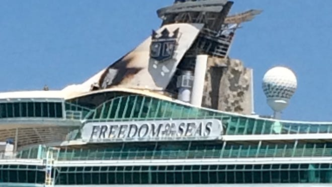 Scorch marks visible at the top of cruise ship Freedom of the Seas after fire broke out July 22, 2015.