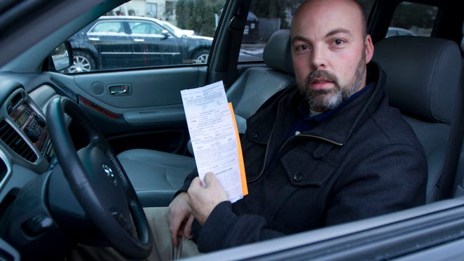 John Phillips of Freehold received a ticket for parking an unregistered vehicle in a parking lot while he and his family were at the Freehold Raceway Mall. Police are using an automated license plate scanning equipment while trolling the parking lot. Wednesday, January 7, 2015 Freehold, NJ Doug Hood/Staff Photographer Gannett