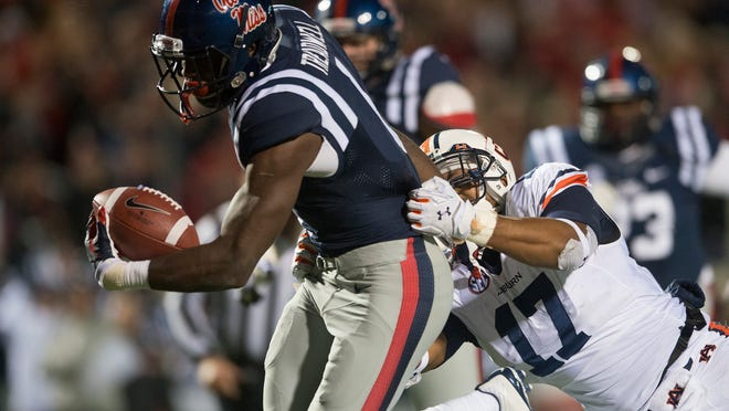 Auburn linebacker Kris Frost tackles Ole Miss wide receiver Laquon Treadwell, forcing a fumble just short of the the goal line to preserve the Tigers' 35-31 victory last week in Oxford, Miss.