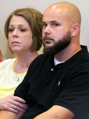 Tommy Hancock, right, and his wife, Sarah, listen to