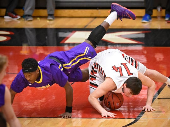 Minnesota State-Mankato's Jalen Pendleton and Andy Foley of St. Cloud State try to get control of the ball during Saturday's game at Halenbeck Hall in St. Cloud.