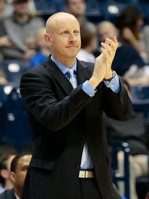 Xavier Musketeers head coach Chris Mack claps as his offense secures a jump ball in the second half.
