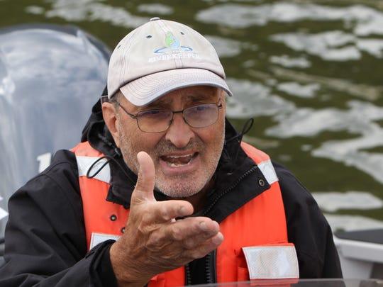 Riverkeeper's John Lipscomb Vice President for Advocacy pilots a boat near the Tappan Zee Bridge and the Gov. Mario M. Cuomo Bridge Sept. 29, 2017.