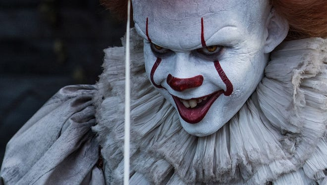 "The evil clown Pennywise threatens the kids of Derry in ""It."""