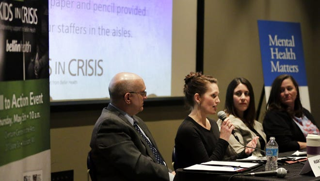 Panelist Casey Hanson speaks to the audience during a Kids in Crisis town hall meeting at the Warch Campus Center on the Lawrence University campus, Thursday, March 10,  2016, in Appleton, Wisconsin.