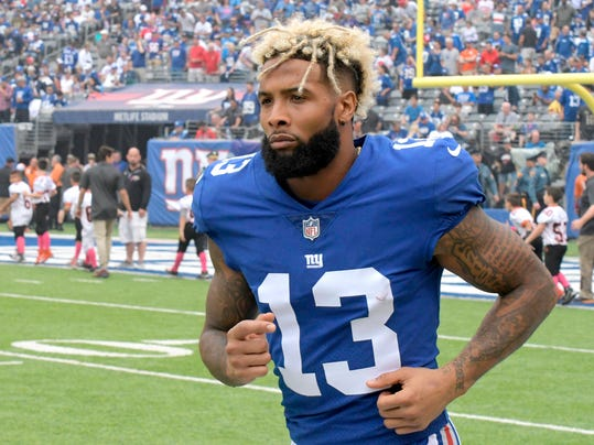 FILE - In this Oct. 8, 2017, file photo, New York Giants wide receiver Odell Beckham warms up prior to an NFL football game against the Los Angeles Chargers, in East Rutherford, N.J.  The Giants have opened their first organized team activities under new coach Pat Shurmur with star receiver Odell Beckham Jr. in the building. Talking on a conference call Monday morning, April 9, 2018, Shurmur says he hasn't spoken with Beckham, whose name has been prominent in trade speculation in recent months. (AP Photo/Bill Kostroun, File)