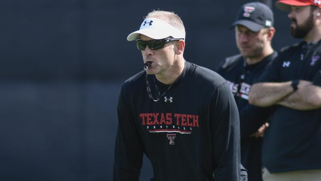Texas Tech coach Matt Wells runs a spring practice March 10 at the Football Training Facility just before coronavirus concerns led to the shutdown of sports. Tech reported Tuesday that it has performed tests for COVID-19 on 218 members of the football program with all 23 who tested positive now recovered.