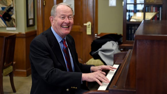 Sen. Lamar Alexander, R-Tenn., plays piano in his office