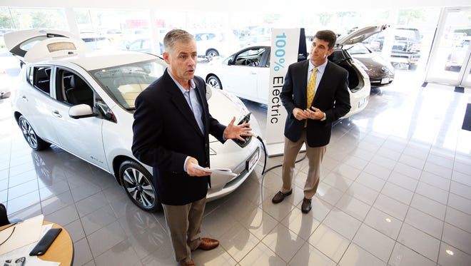 JCP&L President James V. Fakult, left, and Pine Belt Nissan Executive Manager Joe Hill speak. Jersey Central Power & Light and Nissan announced a special $10,000 rebate from JCP&L for the Nissan Leaf 100% electric vehicle at Pine Belt Nissan in Toms River. The program is  meant to boost electric car sales.  Toms River, New Jersey. Tuesday, August 15, 2017.