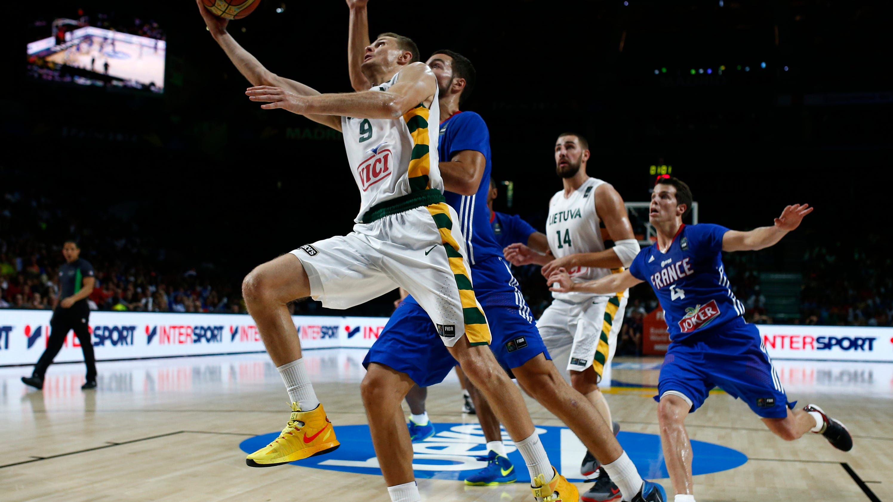 France beats Lithuania 95-93 for bronze at WCup
