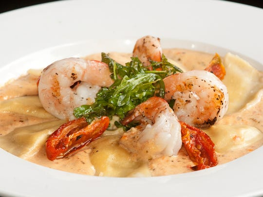 The Ciao Ristorante's butternut ravioli is made with butternut squash, onions, garlic, ricotta cheese and basil stuffed in a traditional ravioli pasta. It is placed in a sauce of tomato cream made with tomatoes, cream, garlic, parmesan and white wine which is first pureed and then sautŽed. Four grilled shrimp and a bit of greens are added to the dish to finish it.June 27, 2018