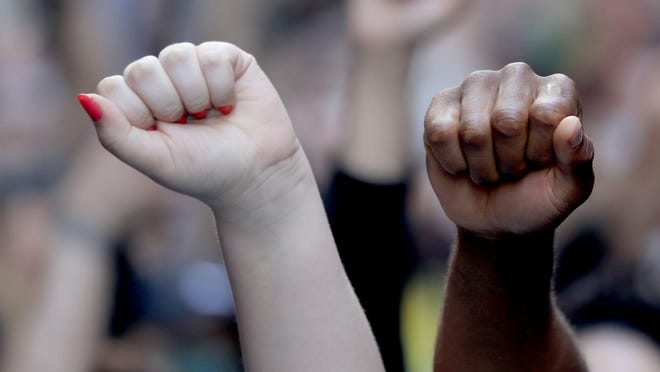 Fists are raised as several thousand protestors marched through midtown Manhattan May 31, 2020 to to protest the death of George Floyd in Minneapolis.