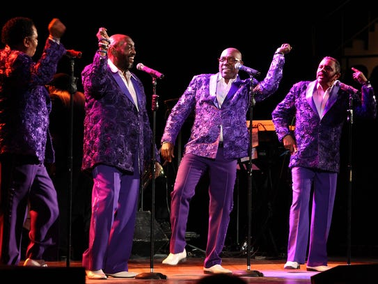 The Temptations thrill a full house during their first