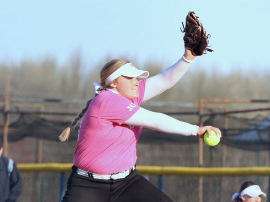 Mater Dei's Allie Goodin pitches during a recent game against Castle. The Wildcats wore pink jerseys with the initials J.G. on the sleeve for Goodin's mother, Julie.
