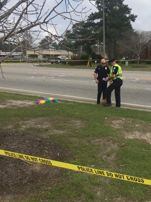 Officials investigate an accident on Highway 59 in Gulf Shores, Alabama. Around 10 a.m. this morning, an elderly man drove his SUV into a group of Gulf Shores High School band members before the start of the Gulf Shores Mardi Gras parade. Twelve band members were injured in the accident.