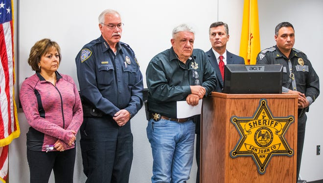 New Mexico Gov. Susana Martinez, left, Aztec Chief of Police Michael Heal, San Juan County Sheriff Ken Christesen, FBI Special Agent in Charge Terry Ward and New Mexico State Police Chief Pete Kassetas address the media to announce the identity of the gunman who shot and killed two students at Aztec High School, Thursday, December 7, 2017.  William Atchinson, 21, then turned the Glock 9mm on himself.