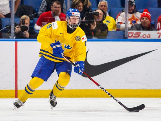 FILE - In this Dec. 31, 2017, file photo, Sweden's Rasmus Dahlin skates during the second period of an IIHF world junior hockey championships game against Russia in Buffalo, N.Y. At 6-foot-2 and 181 pounds, Dahlin is considered the most NHL-ready prospect in this year's draft class for his all-around ability. He's already drawing comparisons to other elite Swedish defensemen such as former Detroit star and seven-time Norris Trophy-winner Nicklas Lidstrom and Ottawa captain and two-time Norris winner Erik Karlsson. (Mark Blinch/The Canadian Press via AP, File)