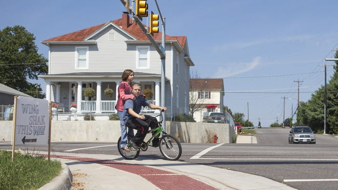 Young Waynesboro residents ride through Basic City on Aug. 23, 2015.