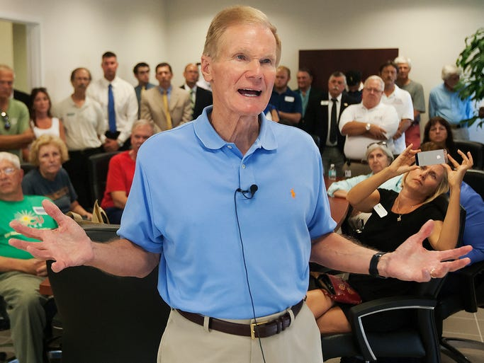 U.S. Sen. Bill Nelson answers questions Friday about a bill he sponsored aimed at ridding the Caloosahatchee River of toxic algae blooms during a meeting at Page Field in Fort Myers.