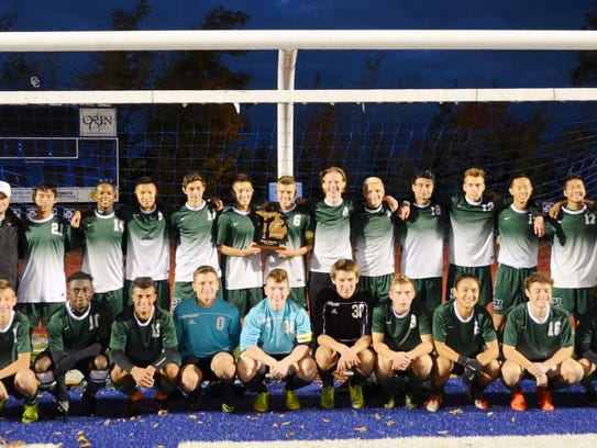 The Novi boys soccer team poses for a team photo after