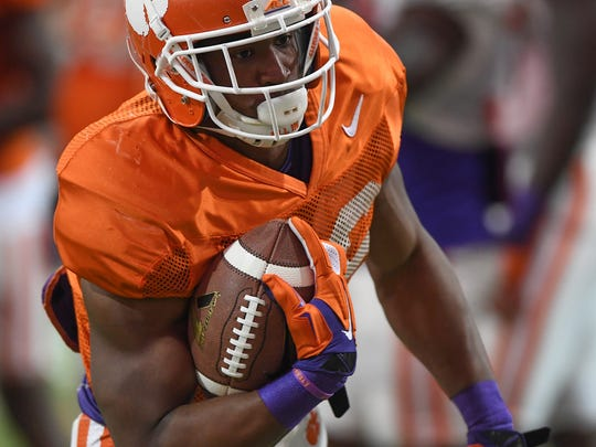 Clemson running back Adam Choice (26) carries the ball during the Tigers spring practice on Monday, April 3, 2017.