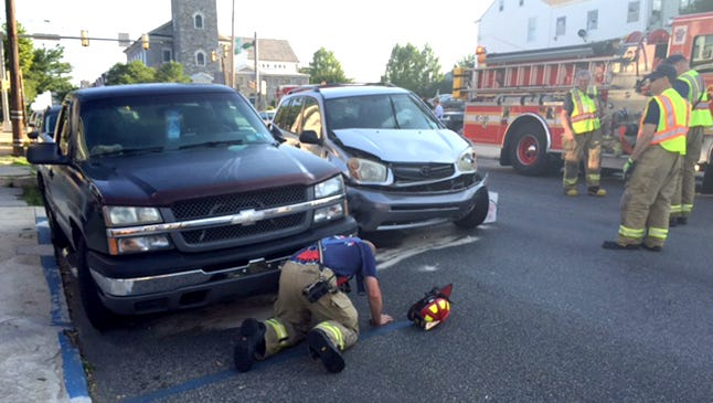 Rescue crews spread an absorbent on the roadway after crash around 7:30 a.m. at 10th and Walnut streets, Lebanon.