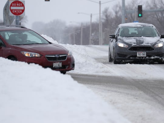 Traffic moves slowly along Ballard Road in Appleton on Monday. Appleton received 21.5 inches of snow during the spring blizzard.   Dan Powers/USA TODAY NETWORK-Wisconsin