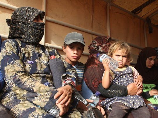 Syrian refugees, fleeing from ISIS fighters and the