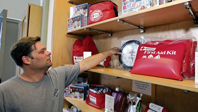 Mike Broermann, of San Francisco, looks over a display of emergency preparedness, first aid and survival kits on June 17, 2005, at the American Red Cross store in San Francisco. New Mexico officials encourage residents to build survival kits for their cars and homes to prepare for winter.
