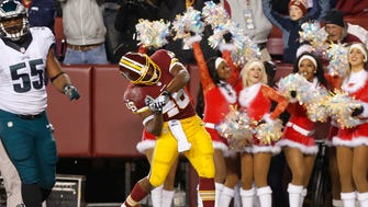 Washington Redskins running back Alfred Morris (46) celebrates after scoring a touchdown against the Philadelphia Eagles in the first quarter at FedEx Field.