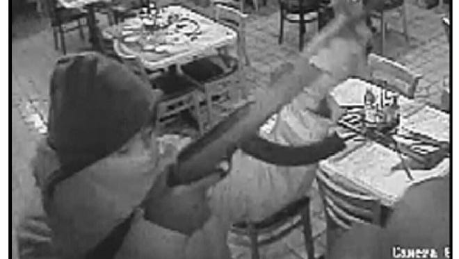 Police are searching for suspects who robbed two Mexican restaurants on the west side last month. This image was taken by a security camera.