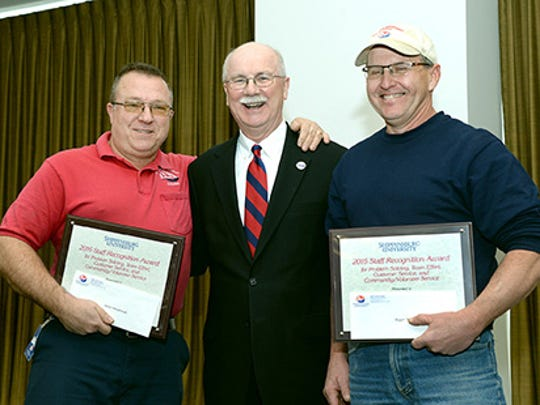 Shippensburg University President Jody Harpster, center, presents the 2016 Employee Recognition Award to Gary Harglerode, left, and Roger Waltz, right.