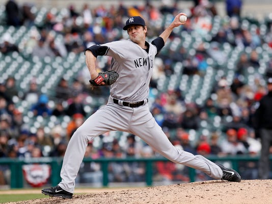 FILE- In this April 9, 2016, file photo, New York Yankees' Andrew Miller pitches against the Detroit Tigers during the ninth inning of a baseball game in Detroit. Dellin Betances and Miller, the Yankees' dynamic duo of late-inning relief pitchers, are overwhelming offenses. Nineteen of their last 26 batters have whiffed. (AP Photo/Duane Burleson, File)