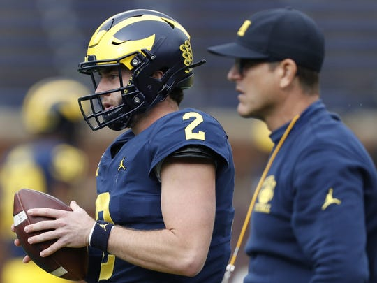 September 28, 2019; Ann Arber, MI, USA; Shea Patterson (2) Michigan Wolverines warm up near head coach Jim Harbaugh before the game against the Knights of Sk Michigan State Stadium's Artel Rieters Photo Credit: Raj Mehta - USA TODAY Sports
