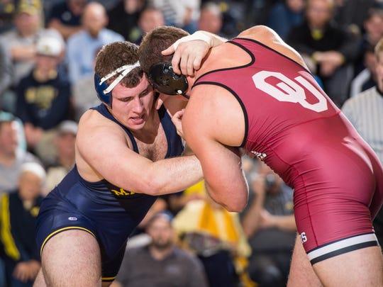 Michigan's Adam Coon battles an Oklahoma wrestler on