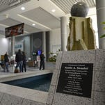 A plaque in honor of Lt. Col. Austin Straubel inside Austin Straubel International Airport in Ashwaubenon.