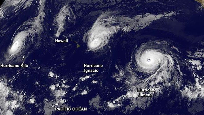 A satellite image shows three hurricanes (Kilo, Ignacio and Jimena) spinning in the Pacific Ocean on Sunday Aug. 30, 2015.