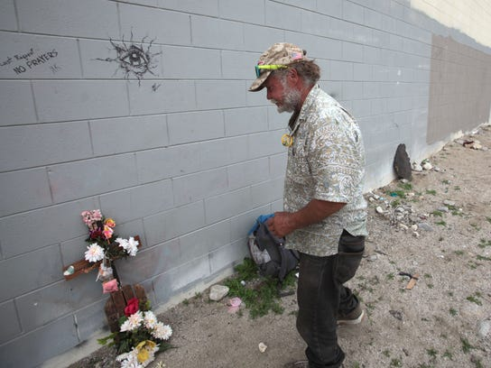 Homeless man George Moyer, 53, marks the area where