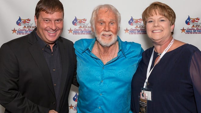 Tracy Pitcox (left) and his wife, Charla, are seen with Kenny Rogers at the Texas Country Music Hall of Fame ceremonies. Pitcox and Rogers both were inducted into the Hall.