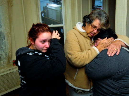 Phyllis Morningstar gets a hug from her neighbor Ellen Nolte, right, as Nolte's daughter Amanda Seymore, left,  sheds tears Monday, Nov. 9, 2015 at 21 South Grant St., Waynesboro. The Morningstar's and about 30 other residents were forced to leave their building until repairs are made to the sewer line. Markell DeLoatch - Public Opinion