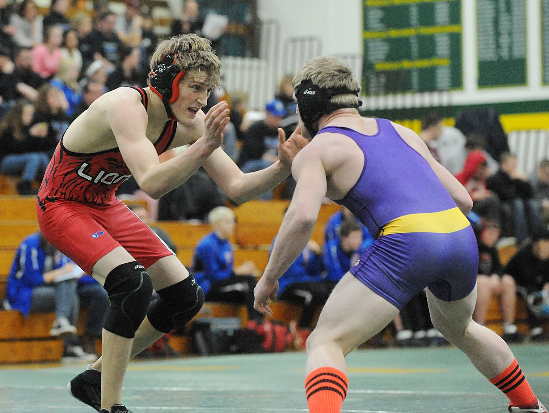 Lomira's Collin Feucht wrestles during a match in 2014.