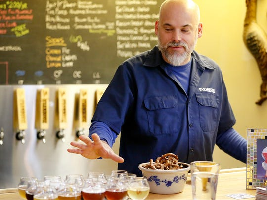 Marty Mattrazzo, owner of Farmhouse Brewery, discusses the flavors of the Taste of the Farmhouse sampling option.