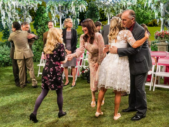 Officiant Bernadette (Melissa Rauch), left, shakes hands with Penny's mom (Katey Sagal) as Penny (Kaley Cuoco) hugs her dad (Keith Carradine) in a 2016 episode of 'The Big Bang Theory' that featured wedding vows for Penny and Leonard.