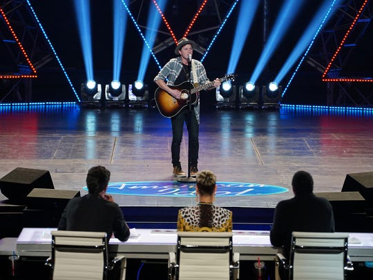 "Cameron Theodos competes on ""American Idol"" during"