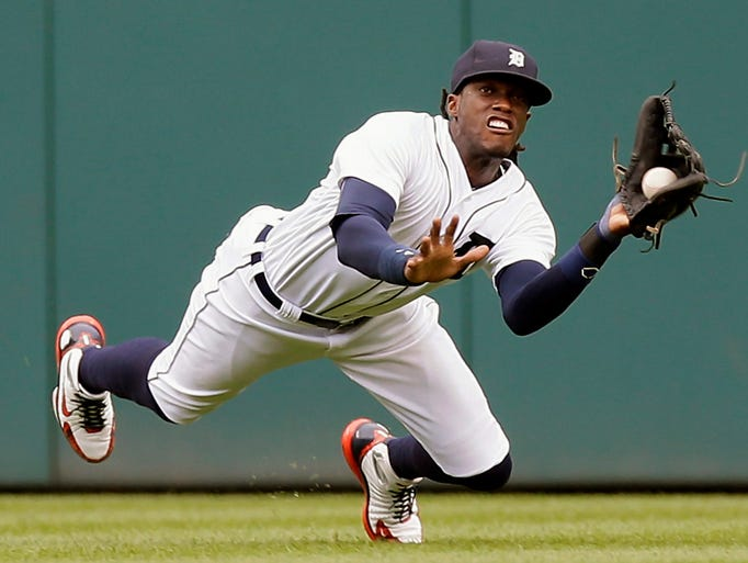 Tigers center fielder Cameron Maybin nearly catches