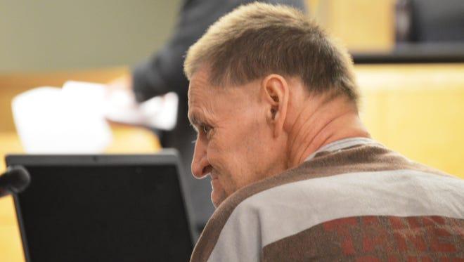 Defendant John Roberts listens to testimony.