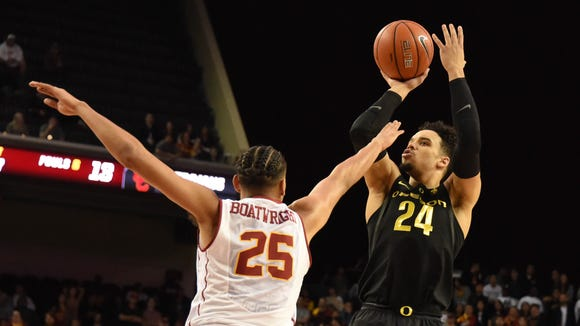 Feb 11, 2017; Los Angeles, CA, USA; Oregon Ducks forward Dillon Brooks (24) shoots over Southern California Trojans forward Bennie Boatwright (25) in the first half of a college basketball game at the Galen Center. Mandatory Credit: Richard Mackson-USA TODAY Sports